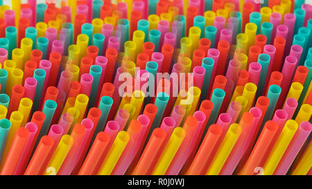 Abstract prismatic representation of one-use colorful plastic drinking straws, concept for excessive use of plastic, or single use plastic ban - Stock Image