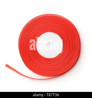 Top view of rolled red ribbon  isolated on white - Stock Image
