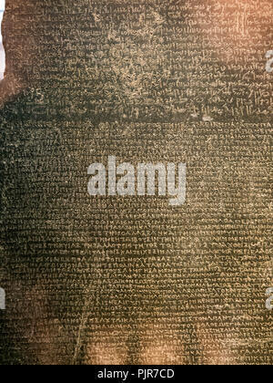 A close up of the text upon the Rosetta stone at the British Museum, London, England - Stock Image