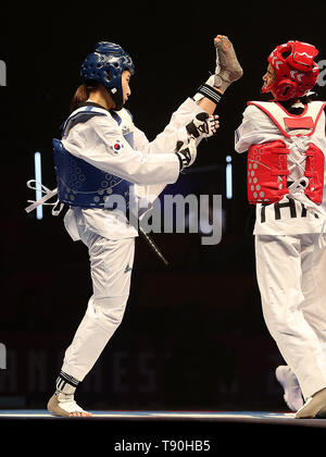 Korea's Jae-young Sim (left) on her way to winning her semi final of the Women's -46kg against Thailand's Julanan Khantikulanon, during the World Taekwondo Championships at Manchester Arena. - Stock Image