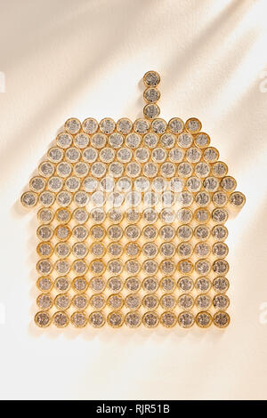 Collection of £1 Pound Coins in the Shape of a House - Stock Image