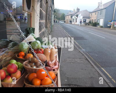 Fresh local produce for sale outside a general stores/greengrocers shop (Peveril Stores) in an English village (Castleton, Derbyshire Peak District) - Stock Image