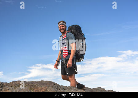 Rugged male backpacker hiking on Appalachian Trail, with pack, in the Great Smoky Mountains National Park in autumn, outside Gatlinburg, TN, USA - Stock Image