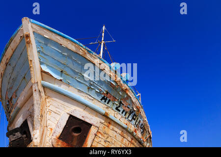 Old traditional Cypriot fishing boat with peeling faded paint at Latchi, Cyprus - Stock Image