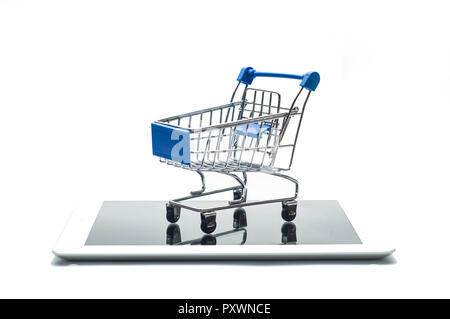 Empty metal shopping cart on a digital tablet or smartphone isolated on white background. Concept image for e-commerce and online shopping - Stock Image