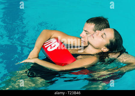 Lifeguard rescuing woman. Toned image. - Stock Image