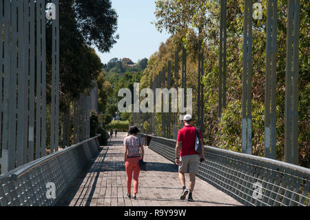 Pedestrian bridge in Birrarung Marr, an inner-city park between the central business district and the Yarra River in Melbourne, Australia. - Stock Image
