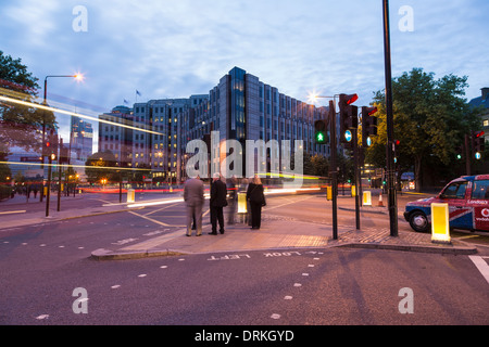 Office workers at traffic lights, London - Stock Image