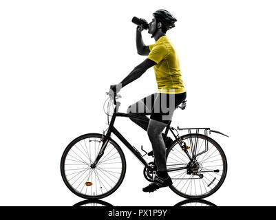 one  man exercising bicycle mountain bike drinking on white background - Stock Image