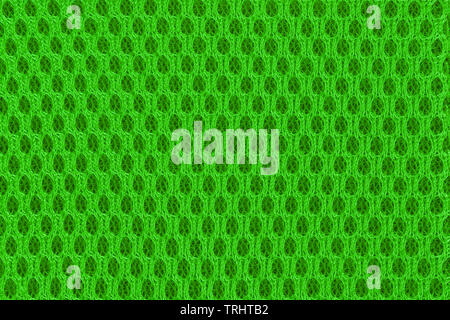 Green modern poriferous material close up. Sportswear material for abstract background and texture - Stock Image
