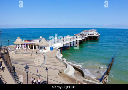 A view of the Pier from the seafront at the North Norfolk seaside resort of Cromer, Norfolk, England, United Kingdom, Europe. - Stock Image