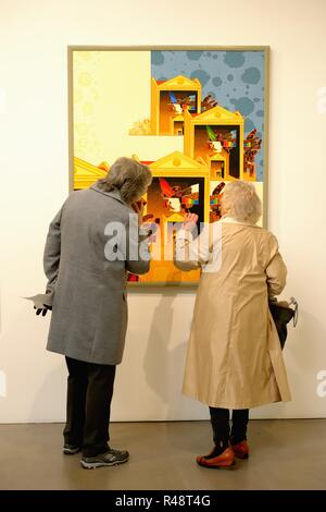 Two senior women discuss artwork by Scottish artist Ronald Forbes in the 'Inside out' exhibition in the STUDIO PAVILION, Glasgow, Scotland, UK, Europe - Stock Image