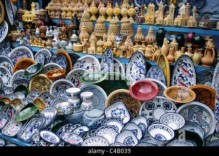 Pottery for sale in local market stall in the town of Kairouan, Tunisia - Stock Image