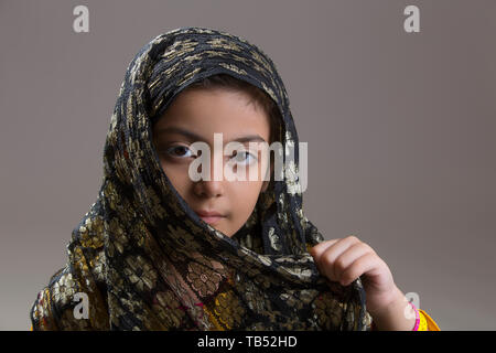 Young Muslim girl with black hijab - Stock Image