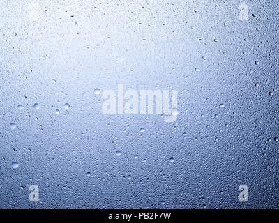 A graphic landscape framed shot of some dew, droplets or condensation. - Stock Image