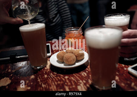 Customers are drinking beers at Giovanni Zampieri bar, Verona, Italy - Stock Image