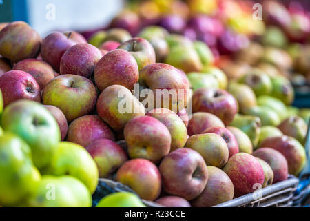 Fresh Red and Various Apples in a Market with Close Up Bokeh Background - Stock Image