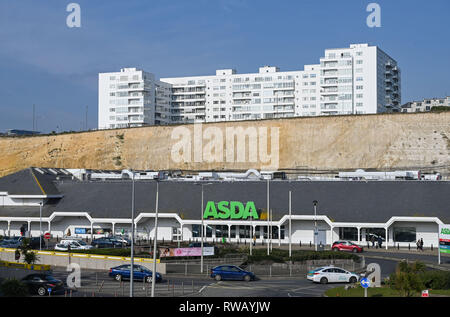 ASDA supermarket superstore in Brighton Marina with flats above on cliffs  Photograph taken by Simon Dack - Stock Image