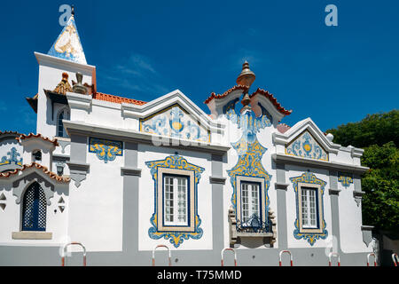 Cascais, Portugal - May 3rd, 2019: Facade of house covered in blue Portuguese style azulejo tiles in Cascais, Portugal - Stock Image
