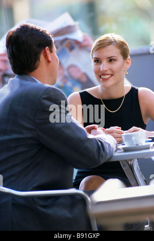 Business couple meeting at a cafe in Brisbane Queensland Australia - Stock Image