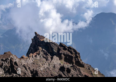 Clouds forming over the mountains and volcanic ridge at Roque de los Muchachos on La Palma, Canary Islands - Stock Image