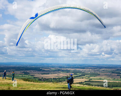 A pilot with his paraglider attempting take off at Carlton in Cleveland on the North Yorkshire Moors - Stock Image