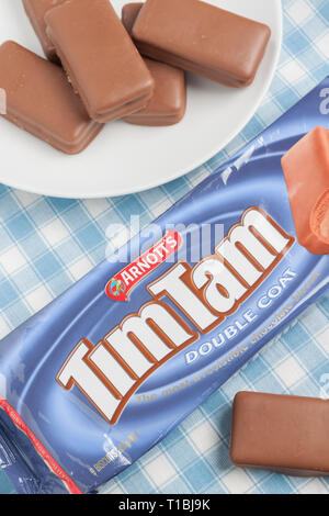 Tim Tams a popular brand of cream filled chocolate covered biscuit made by Arnott's Biscuits Limited in Australia - Stock Image
