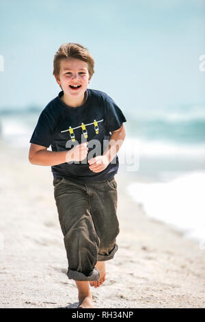 Smiling boy on beach - Stock Image