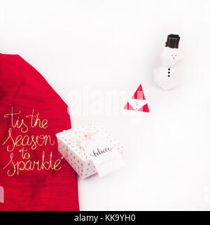 Christmas Decoration with Gifts and Lights with snow man and tis the season to sparkle best for background image - Stock Image