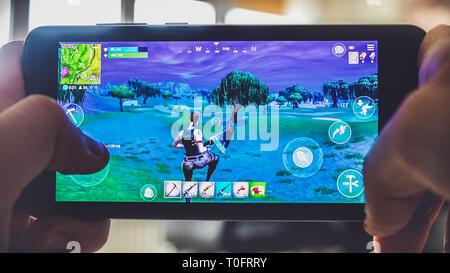 Fortnite gameplay battle royale game smartphone  - Stock Image