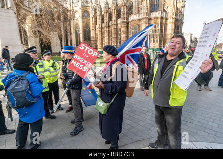 London, UK.  9th January 2019. Protests by stop Brexit group SODEM (Stand of Defiance European Movement) and pro-Brexit campaigners continue opposite Parliament. Among the pro-Brexit campaigners were again some extreme-right 'yellow jackets', most of whom were fairly subdued. One man (right) led a few others in shouting insults at SODEM protesters rather than and sensible protest, but some other Brexiteers had come to support Brexit rather than cause trouble. Credit: Peter Marshall/Alamy Live News - Stock Image