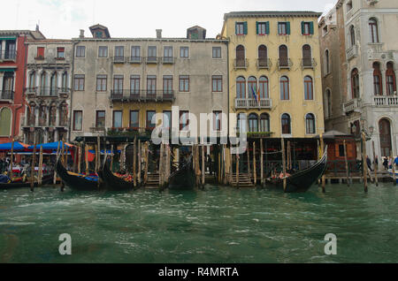 row of gondolas taken from a taxi boat Venice Italy - Stock Image