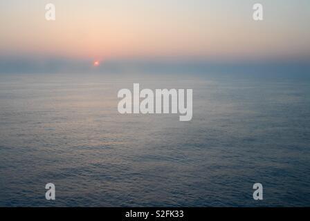 Sun set over the sea - Stock Image