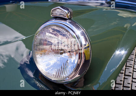 Headlight classic british sports car UK chrome - Stock Image