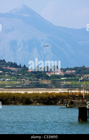 Airplane landing at Corfu, Ioannis Kapodistrias Airport, Greece - Stock Image
