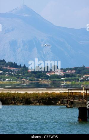 Airplane landing at Corfu, Ioannis Kapodistrias Airport, Greece - Stock Image