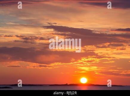 Sunset over ocean - Stock Image