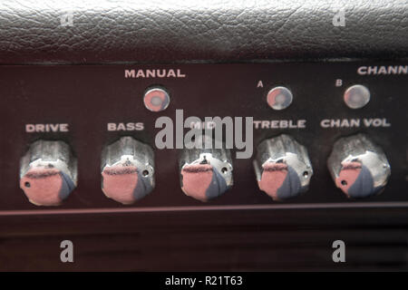 Dials that set the range and channel for a guitar amplifier - Stock Image