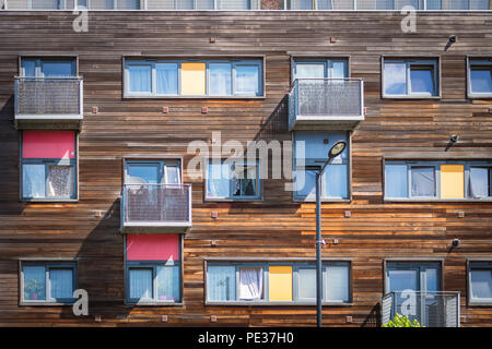 Wooden residental building in Greenford (London) with yellow and red balconies - Stock Image