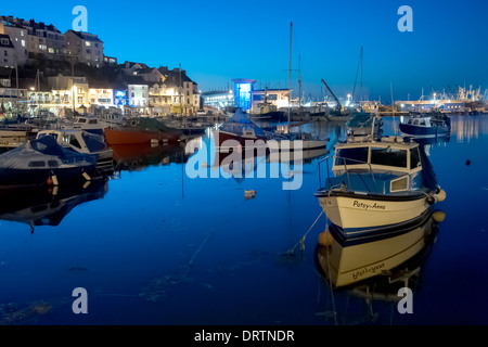 Evening image of the inner harbour at the historic commercial fishing port of Brixham in South Devon. - Stock Image