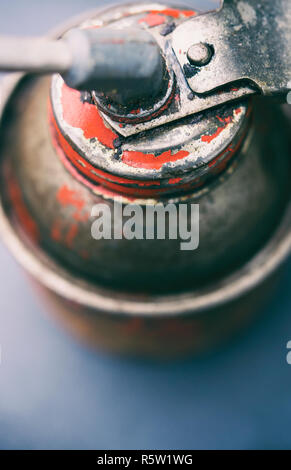 Close-up of an old red oil can - Stock Image