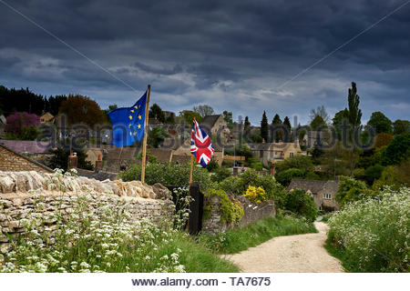 European and British flags in village in the Cotswolds in Oxfordshire with Britain approaching Brexit. - Stock Image