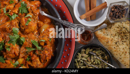 Top down close up view of a delicious chicken tikka masala with Indian spices - Stock Image