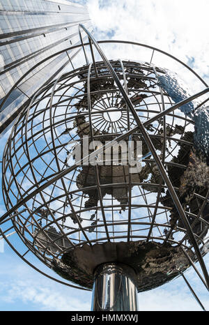 Looking upwards at the Trump International Hotel and Tower and steel unisphere globe at Columbus Circle, New York, - Stock Image