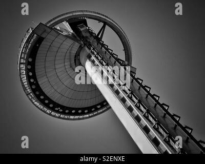 A view looking up at the Faro de Moncloa observation tower - a tourist attraction in Madrid, Spain. Panoramic views are possible from to observation platform. Photo © COLIN HOSKINS. - Stock Image