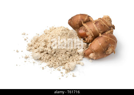 Fresh raw kencur rhizome and heap of dried powder isolated on white background - Stock Image