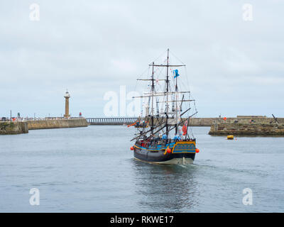 The Bark Endeavour leaving Whitby harbour. - Stock Image