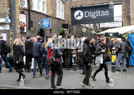 Digitas marketing & technology business office sign & people street outside Backyard Market in Brick Lane East End London E1 UK  KATHY DEWITT - Stock Image