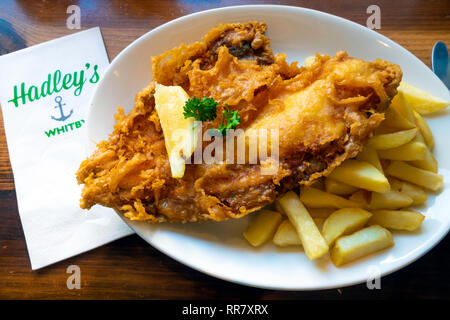 A Yorkshire Meal of Plaice and chips and bread and butter at Hadleys Cafe in Whitby England - Stock Image