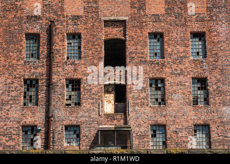 Old derelict brick industrial historical warehouse at Liverpool docks. - Stock Image